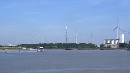 malom : windmills nearby River Scheldt in Antwerp city, Belgium in summer 2018