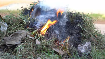Burning grass outside the house in countryside