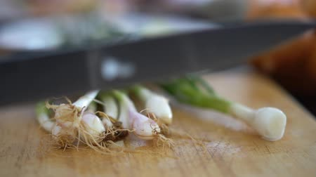 Asian person cutting and get rid of spring onion roots, Thai cooking preparation