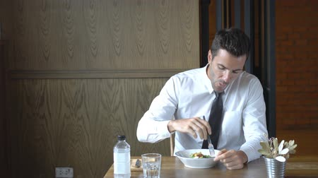 Healthy businessman enjoy eating salad