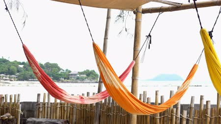 Colorful hammock with bamboo fence and sea view in Phangan island, Thailand