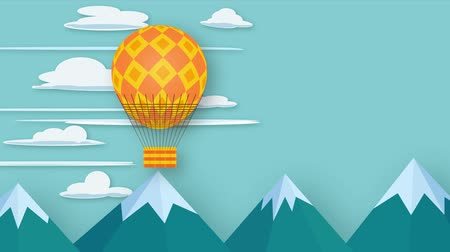 yüzer : 2d animation orange hot air balloon flying over mountains with copy sface Stok Video