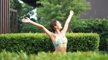 Asian girl enjoy morning fresh air and working out.