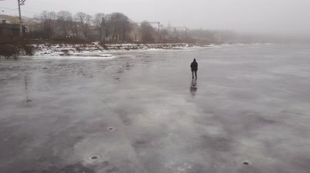 riga : Aerial view on fisherman at a frozen river in Riga, Latvia. 4k footage. Stock Footage