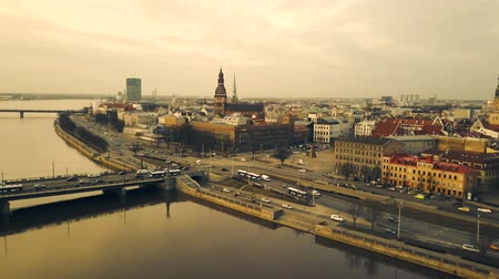 Латвия : Aerial view from drone on the busy city Riga during sunset, Latvia. Time lapse.