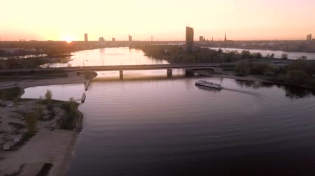 riga : Aerial view of Daugava river in Riga during sunset. City landscape view from the air.