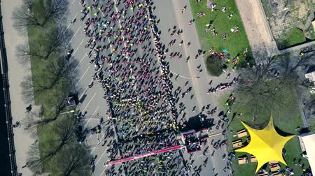 latvia : Aerial view from drone on crowd of people who is starting their run on marathon event.