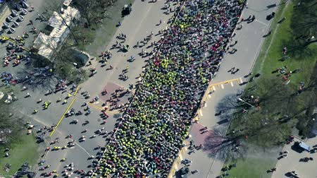 participants : Aerial view from drone on crowd of people who is starting their run on marathon event.