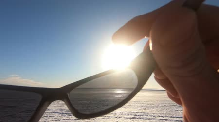 took : Removing sunglasses from the first person on the lake in winter (POV) The hand removes sunglasses. Stock Footage