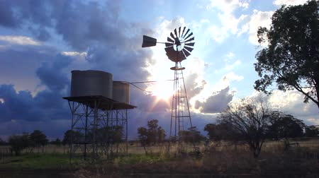 bushland : Windmill and Water Tanks at Sunset