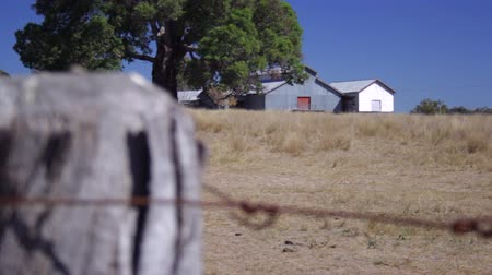 farpado : Wire Fence With Farm Sheds (Pull Focus)