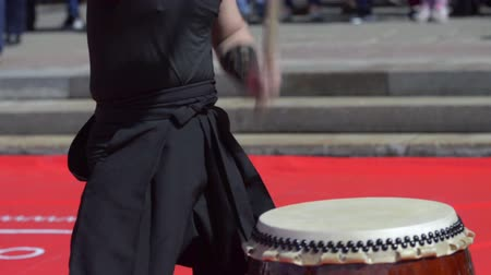 musical intrument : Japanese artist playing on traditional taiko drums Stock Footage