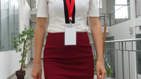 targeted : Business woman walks in a business center. Front view