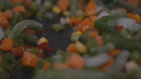 bezelye : frozen vegetables cooking in a frying pan close up hd footage slow motion