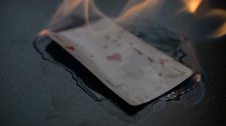 sortudo : Abstract ace of hearts burns on black background hd slow motion footage for you ideas Vídeos