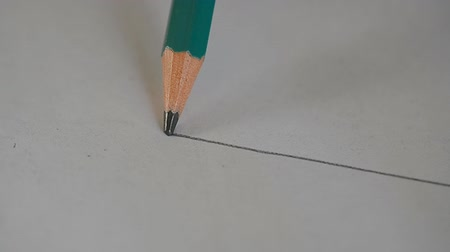 grafit : Artists hands drawing wooden pencil writes line.