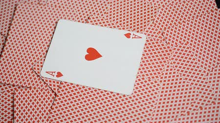 turn table : playing cards red background and ace of hearts