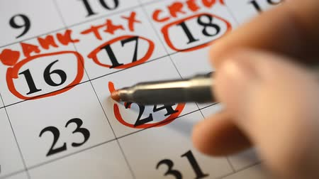 mensal : Signing a day on a calendar by red pen tax, bank, credit word Vídeos