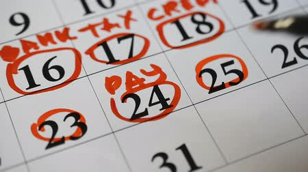 adó : Signing a day a calendar by color marker word pay, credit, tax, bank