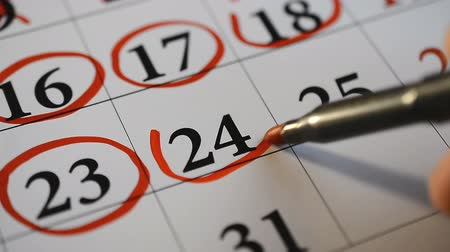 mensal : Signing a day on a calendar by red pen twenty four and twenty five number