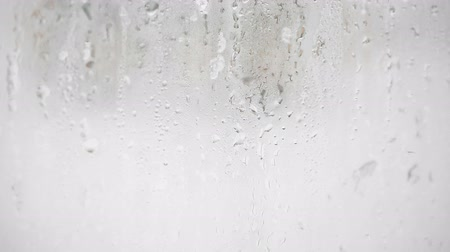 taje : Snow falls on the glass and melts into drops hd footage background Dostupné videozáznamy