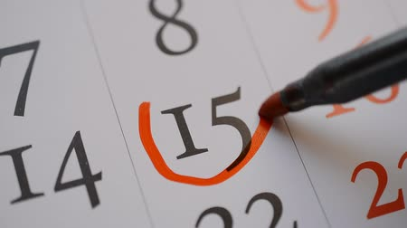 mensal : Signing a day on a calendar by red marker the fifteenth date Vídeos