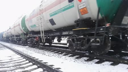 vagone : freight train railway rails in motion, winter time