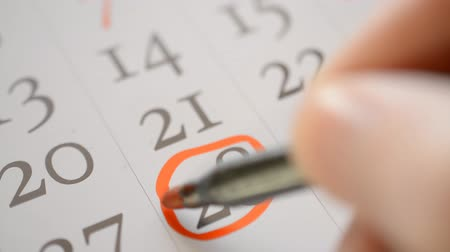 yirmi : Signing a day on a calendar by red pen, thanksgiving day usa twenty eighth