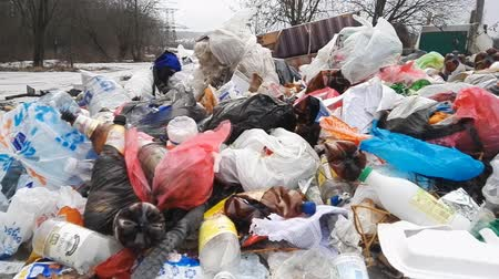 dirty beach : Minsk, Belarus - March 5, 2019 Plastic bottles and bags. garbage dump in nature
