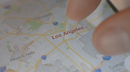 топография : Minsk, Belarus - May, 2019: Los Angeles mobile map search