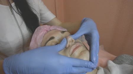 taberna : Cosmetologist make massage of nose