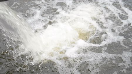 liquid : industrial water flow falls into the river hd footage
