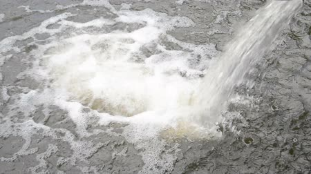 descarga : industrial water flow falls into the river hd footage