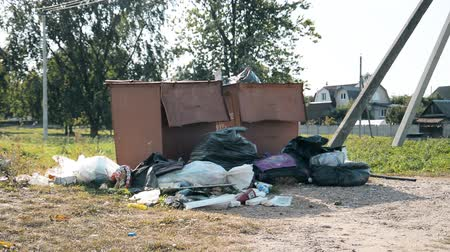 ekosistem : Minsk, Belarus - September 09, 2019: Plastic bags of garbage are in the container, the problem of recycling plastic waste concept