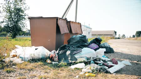çöplük : Minsk, Belarus - September 09, 2019: Plastic bags of garbage are in the container, the problem of recycling plastic waste concept