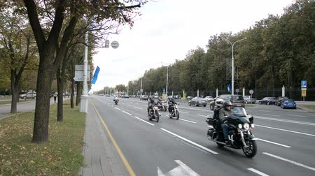 dragging : Minsk, Belarus - September 14, 2019: convoy of motorcyclists moving along the road in Minsk, Independence Avenue, closing of the motorcycle season, police escort