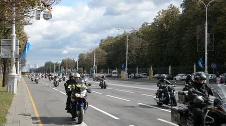 helm : Minsk, Belarus - September 14, 2019: convoy of motorcyclists moving along the road in Minsk, Independence Avenue, closing of the motorcycle season, police escort