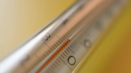enstrüman : thermometer on a yellow background hd stock footage