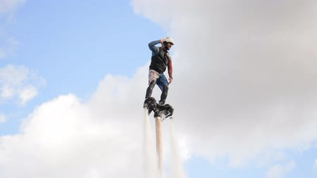 redazione : Minsk, Belarus - September 14, 2019: Man on Flyboard above Svisloch river over blue sky