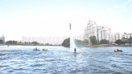 nástup do letadla : Minsk, Belarus - September 14, 2019: Show flyboarders on the river Svisloch at the celebration of the city day in Minsk hd footage