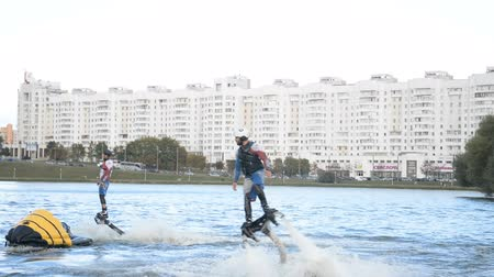 białoruś : Minsk, Belarus - September 14, 2019: Show flyboarders on the river Svisloch at the celebration of the city day in Minsk hd footage