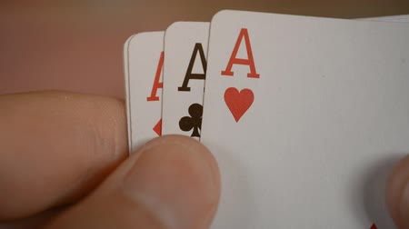 kezdődik : playing cards poker hands four ace close-up hd stock footage Stock mozgókép