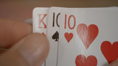 kezdődik : playing cards poker hands full house three ten and two king Stock mozgókép