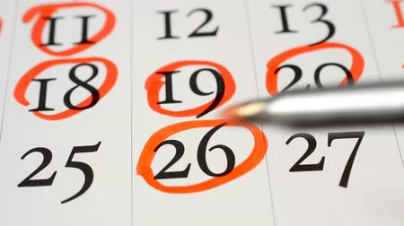 planlamacı : Red Marker Circled calendar page date 11, 18, 19, 18 20 26 hd stock footage Stok Video