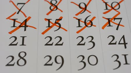 plánovač : STOP MOTION: Crossing out (red marker) a numbers in a calendar page - Macro hd stock footage, past days