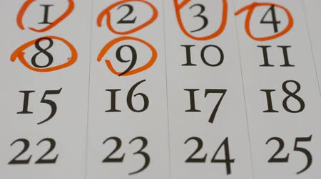 organizador : STOP MOTION: circle the dates on the calendar page close-up footage hd, past days concept Stock Footage