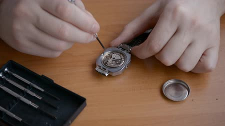 watchmaker hands is repairing the vintage hand watch close-up Stock Footage