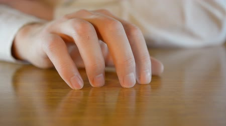 boring : Closeup male hand nervously knocking fingers on the table hd stock footage.