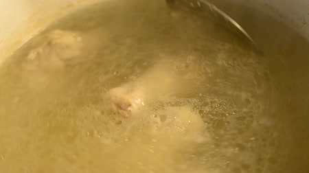 A lot of chicken legs boiling in the pan hd stock footage 影像素材