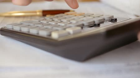 calcular : Man With Calculator Filling A Form hd stock footage Vídeos